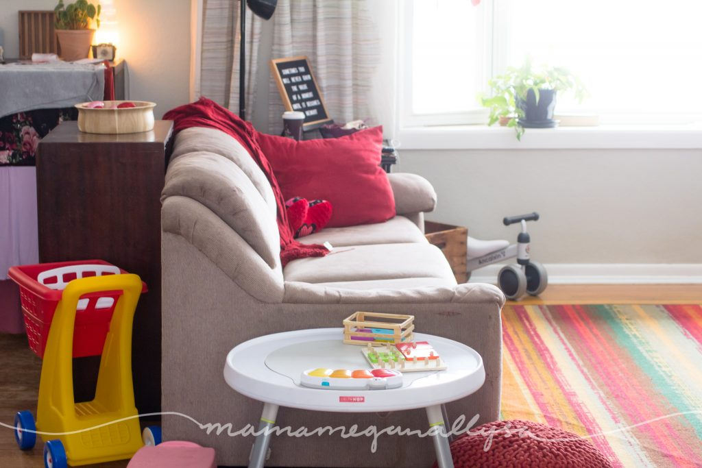 a play table at the end of a sofa in a living room play space