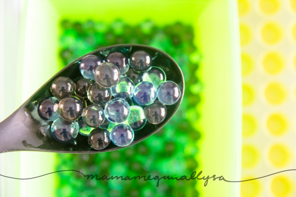 a close up of the green waterbeads