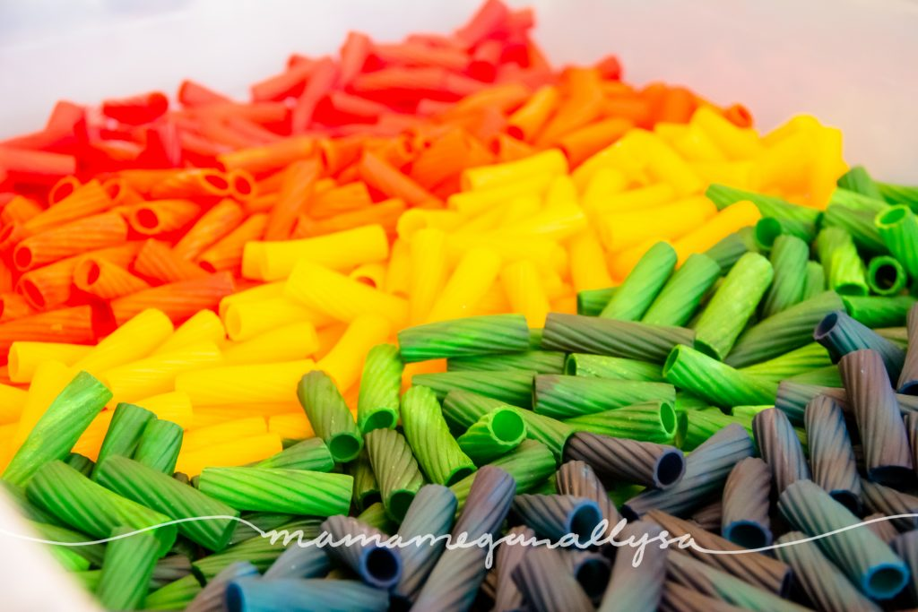 close up of my DIY rainbow noodle sensory bin filler