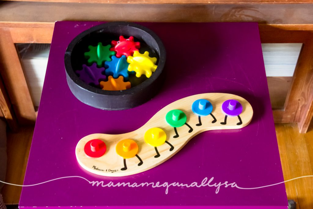 a rainbow caterpillar puzzle on a play table
