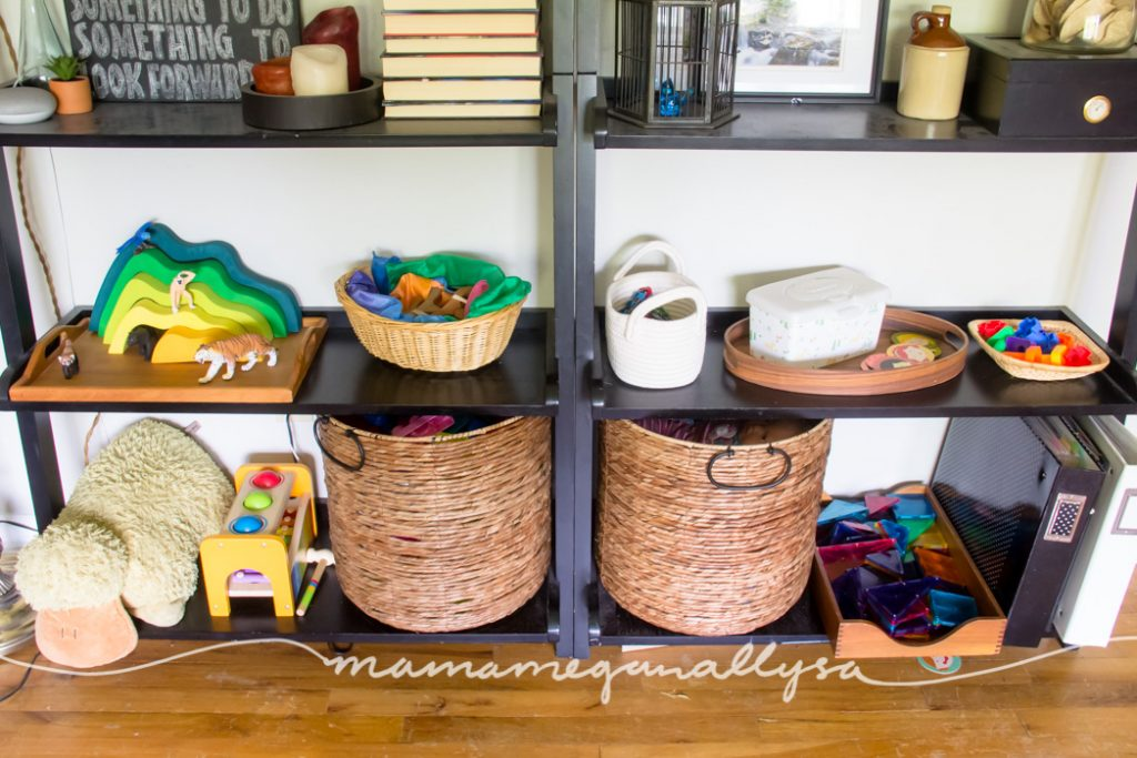 a closer look at the toy rotation with toddler toys displayed on her play shelves in trays and shallow baskets