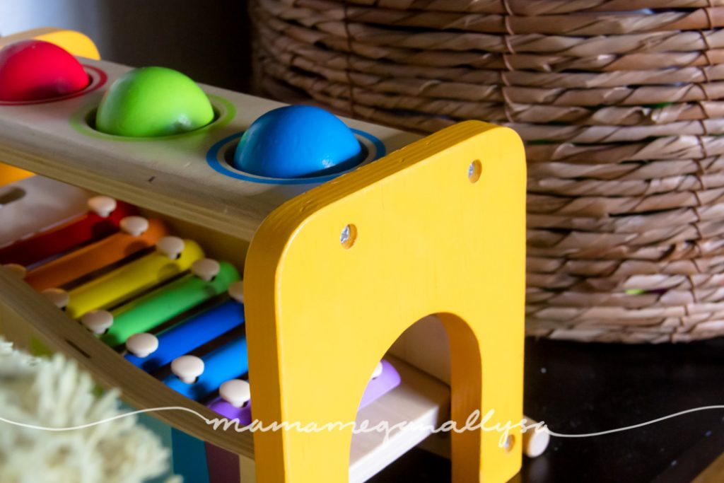 a close up of the Hape hammer bench with three balls on the top and a xylophone under the balls