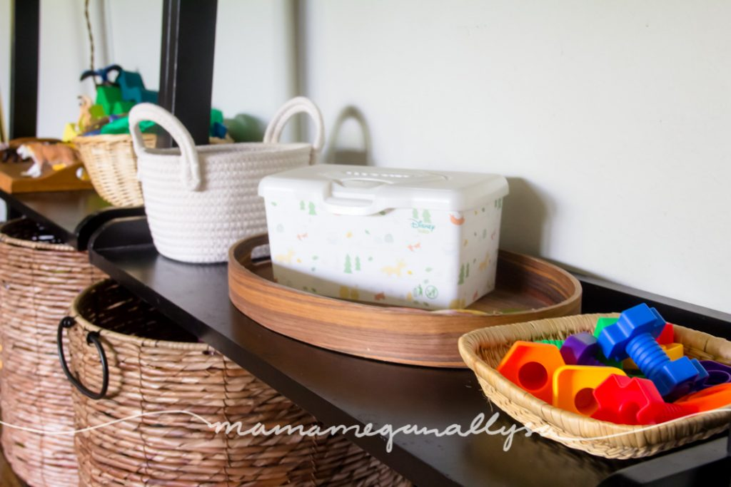 our toy rotation toys displayed in baskets and trays for easy access for the toddler