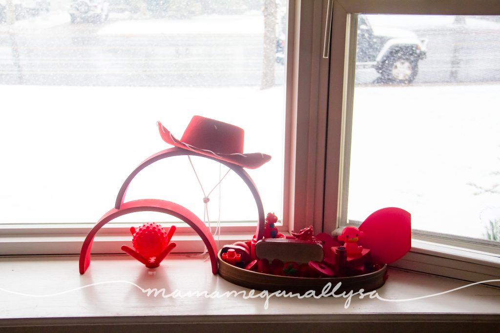 red discovery tray in the window