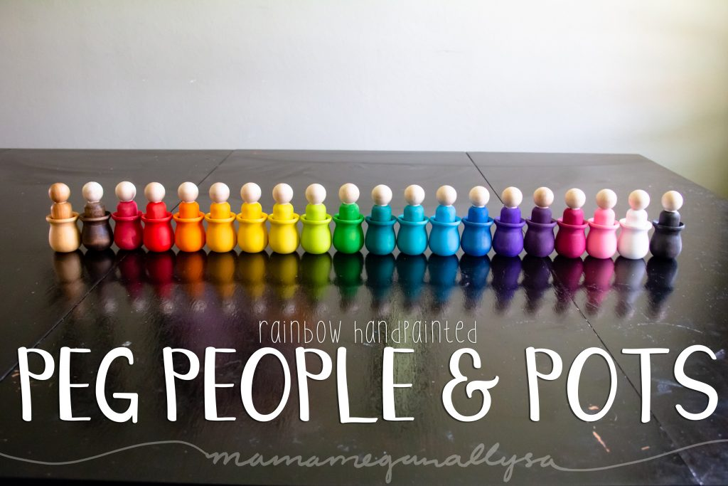 rainbow hand-painted wooden peg people and bean pots for loose parts play, all lined up