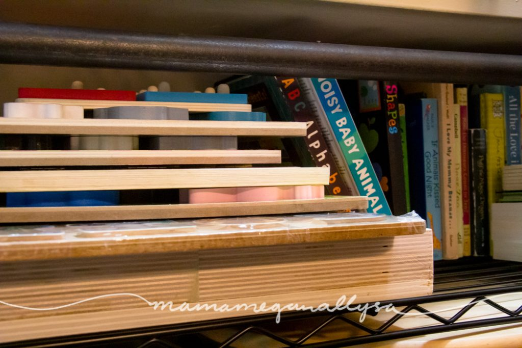toddler puzzles stacked up next to some board books