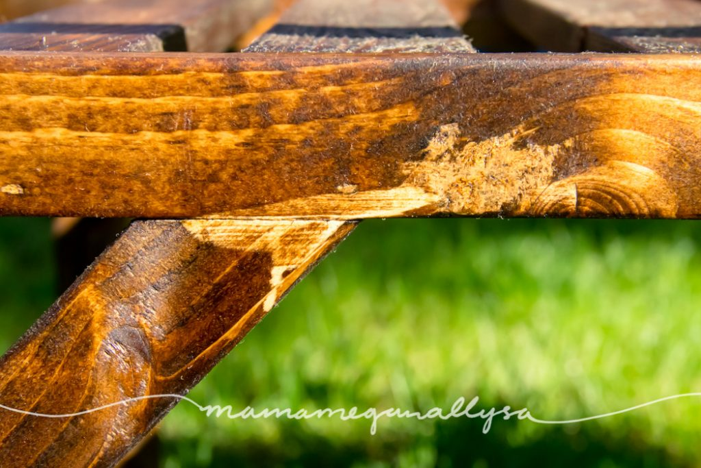 a close up of the table showing how wood glue inhibits the wood satin