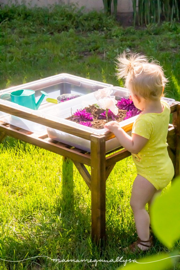 Toddler playing at the side of the DIY sensory bin table