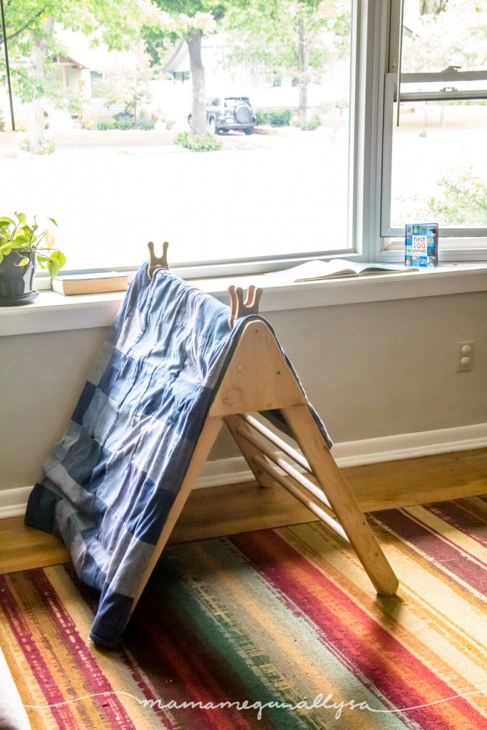 DIY wooden pickler turned into a tent in front of a large window