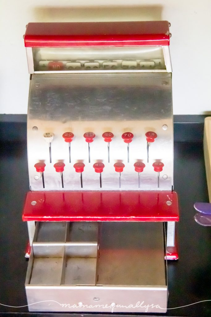 her red and silver vintage metal cash register