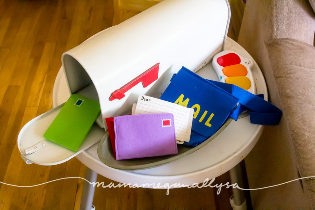 a mailbox and felt mail play set on a play table