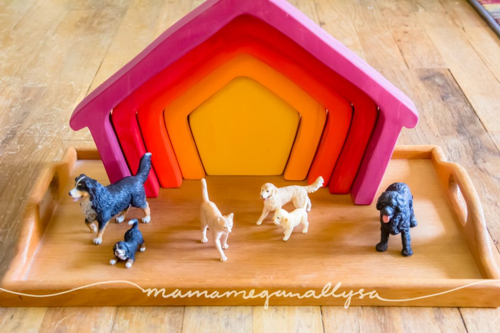 our house stacker and play animals on a wooden tray