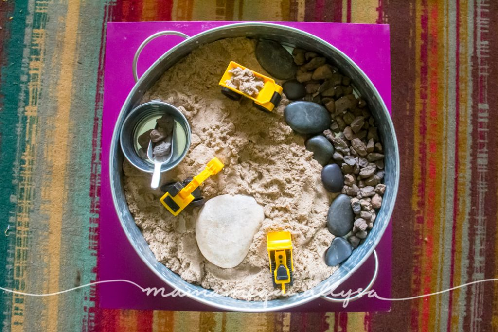 a top down view of our Sand an Stones Construction Trucks Small World Sensory Bin