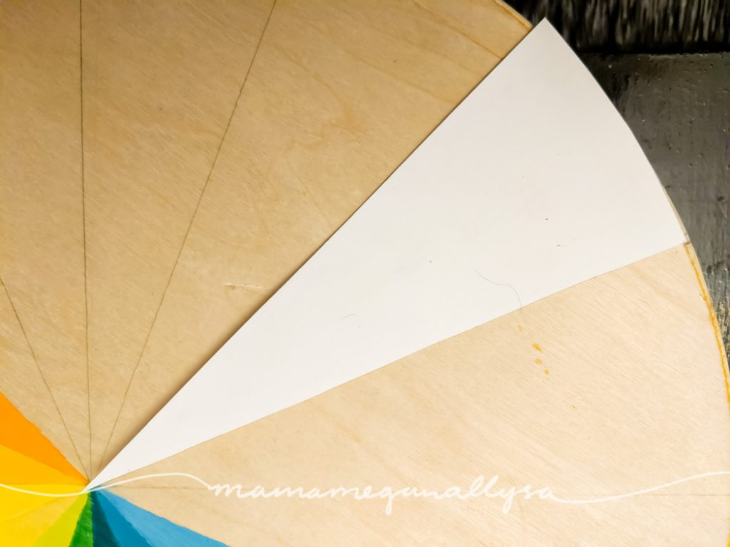 the triangle paper template created to divide the circle into sections for painting