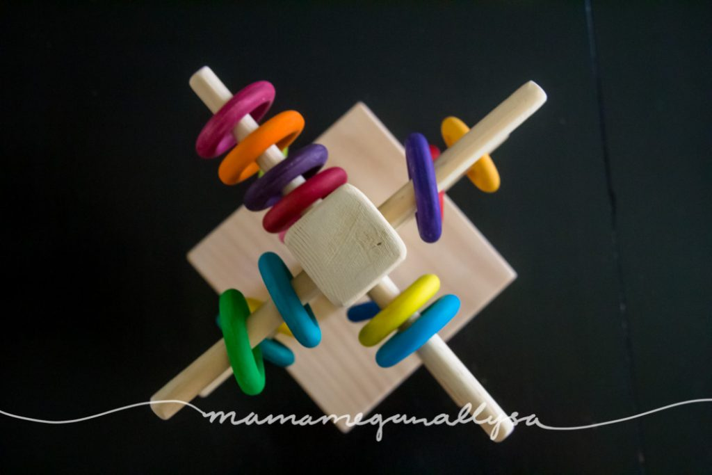 a top down view of our DIY wooden ring tree for loose parts play