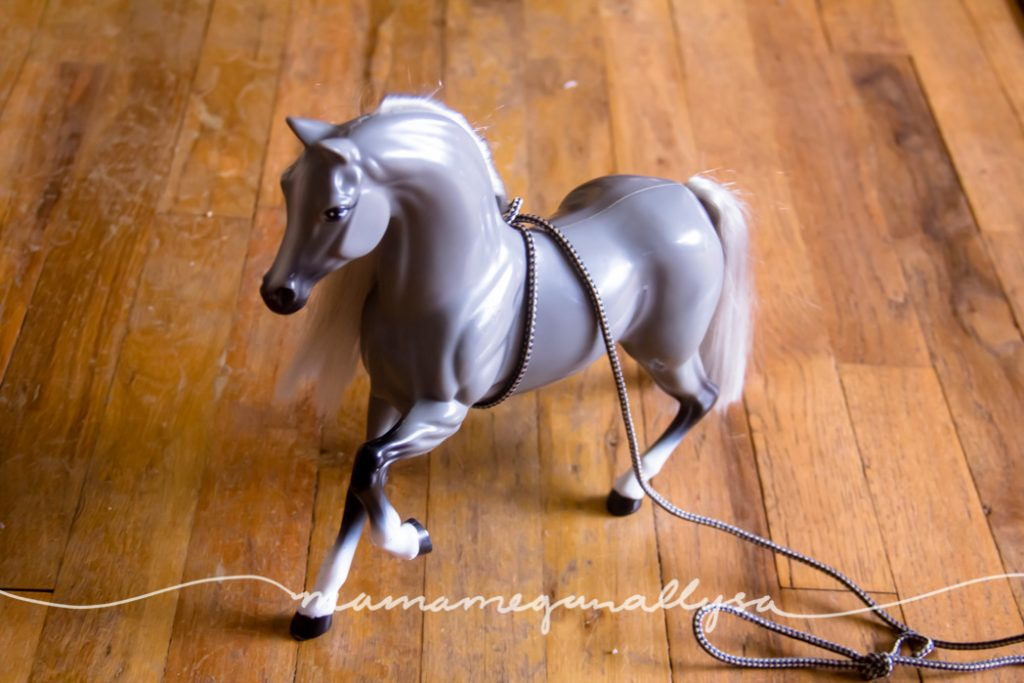 "A large horse figurine that she drags around on a ""leash"" for walks"