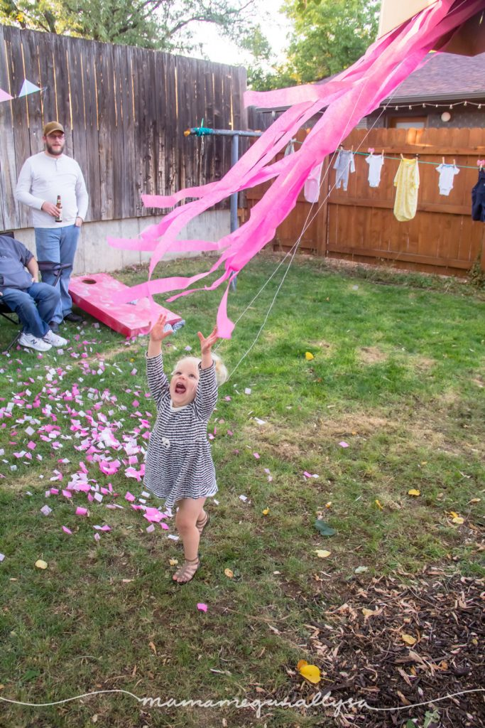 Bitty playing in the streamers after we opened the gender reveal surprise box