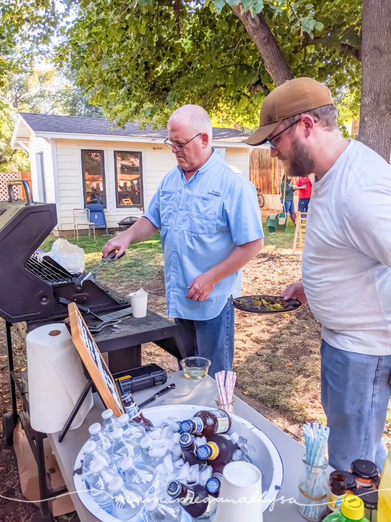 Zak and his dad busy tending the grill at the party