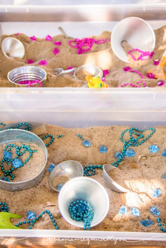 With plenty of buckets and scoops scattered among the pink and blue treasures our gender reveal sensory bin was a no fail party activity!