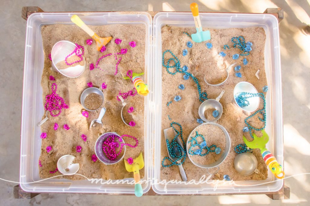 Our Sensory bin table has a two bin system and that was just begging to be split pink and blue!
