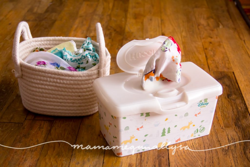 What kid doesn't love pulling all the kleenex out of a box?! Using cloth hankies and an old wipes box she can unload it to her hearts content!