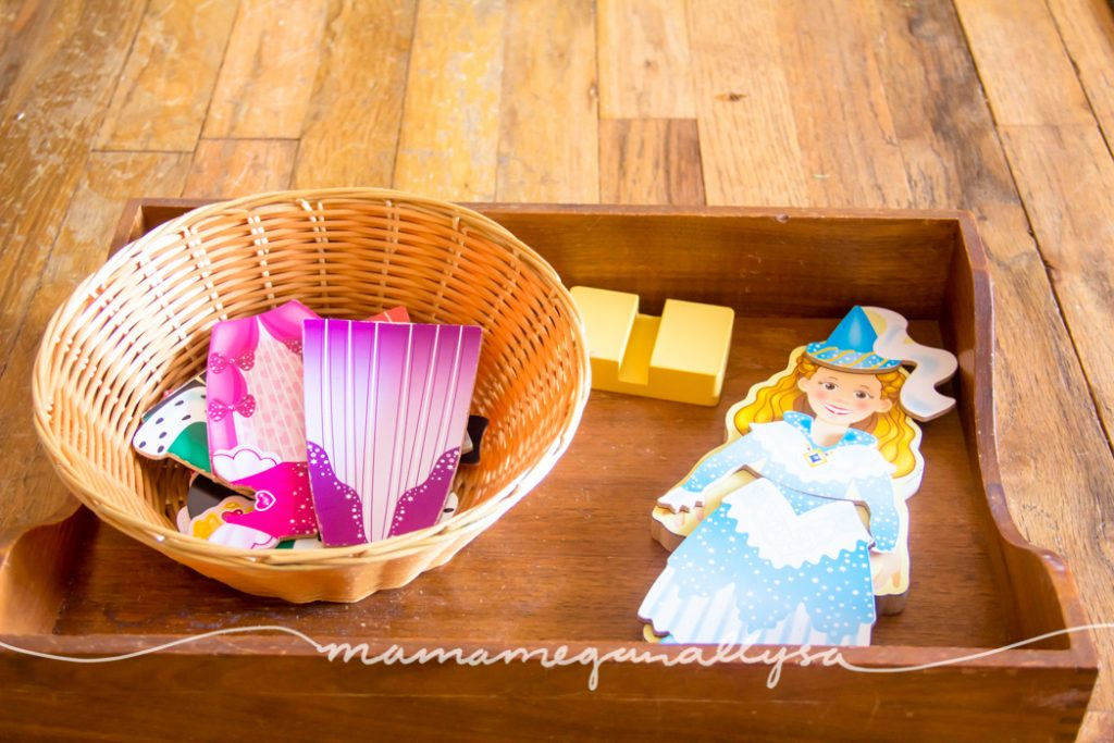Magnetic dress up princess doll displayed on a tray