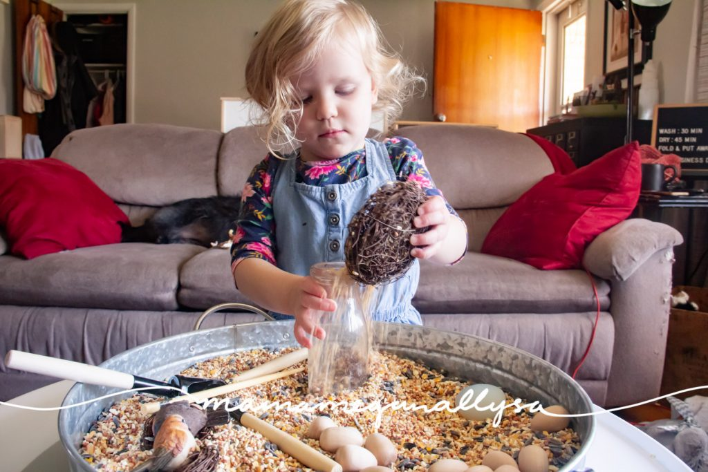 A birdseed sensory bin isn't complete with out some nests which ended up acting a lot like bowls for our play