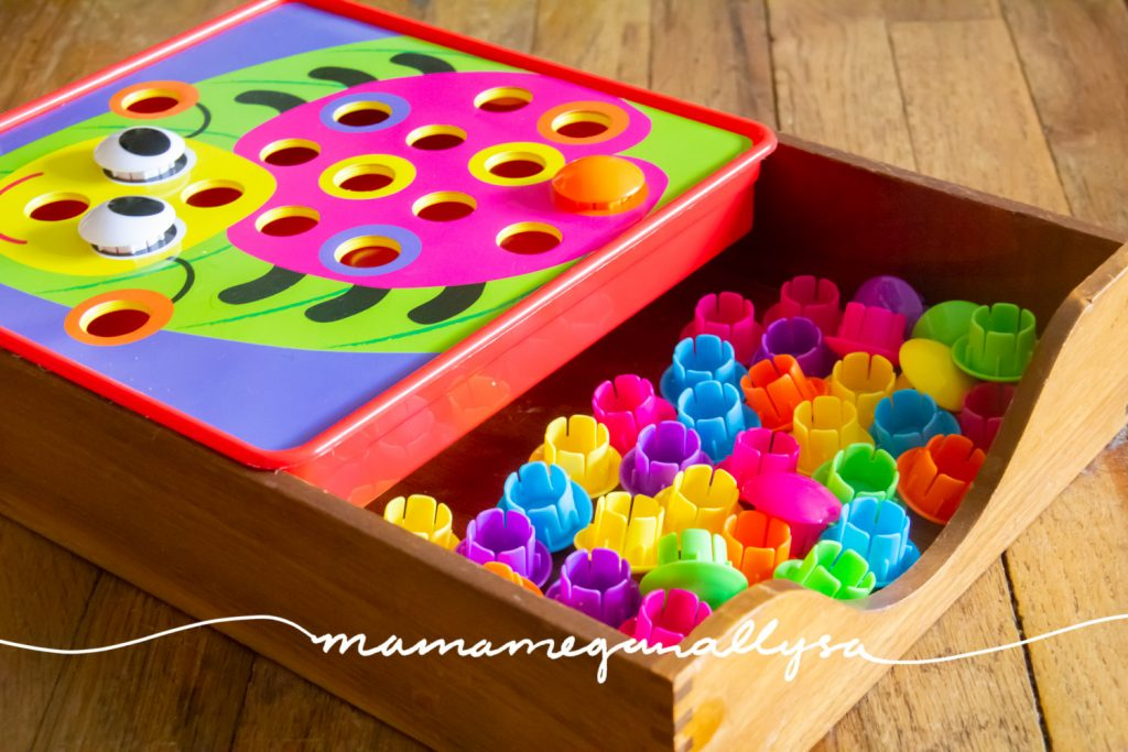 The button puzzle has lots of fun springy themed cards to use but to be totally honest my 2.5 year old prefers to just randomly place the colorful buttons on the tray however she likes.