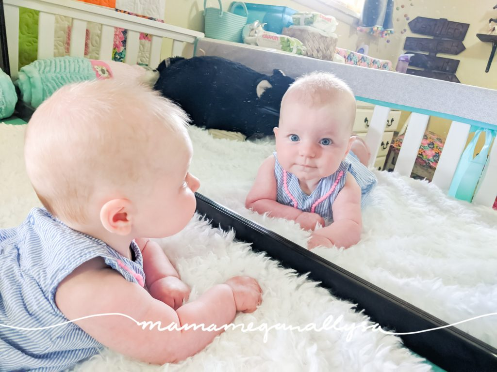 Mirrors are wonderful for newborn playtime! A newborn begins to recognize faces almost right away and loves to study their own face!