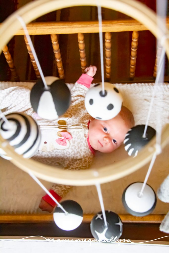 a high contrast mobile is a great addition to your newborn playtime. the bold patterns help develop their eyesight and tracking