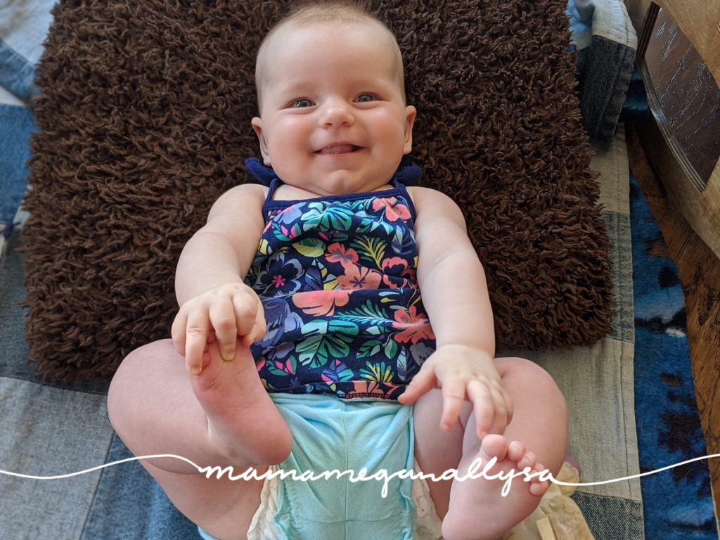 one of the first 3-6 month milestones she hit was finding her toes