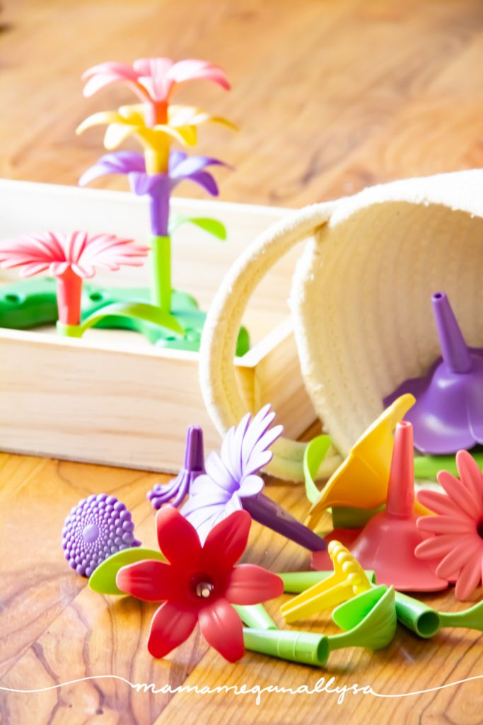 green toys build a bouquet is a great fine motor toy and also a fun invitation to build as we can mix and match the flowers however we want