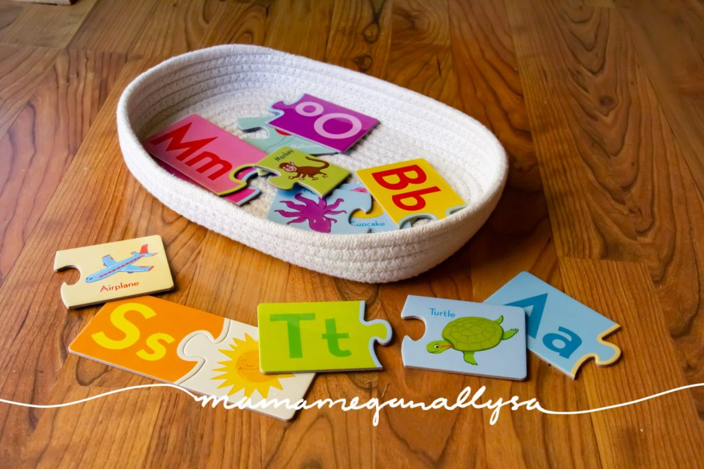 a small selection of ABC 2 part puzzles keep her from feeling overwhelmed