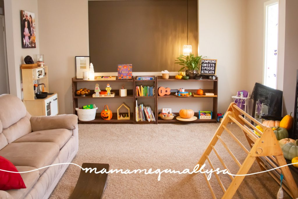 The livingroom/shared playroom is where we spend the majority of our day and I wouldn't have it any other way. With toy shelves, a play kitchen, babydolls, and plenty of gross motor options we have plenty to keep us busy!