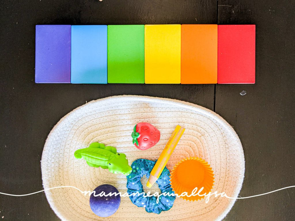 A basic rainbow of color tablets and a basket of random objects from around the house that match the colors