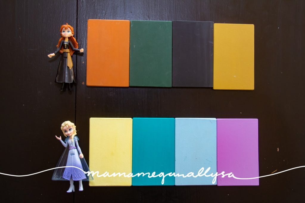 An Anna and Elsa figure with 4 color tablets next to each figure showing the general color palette of each