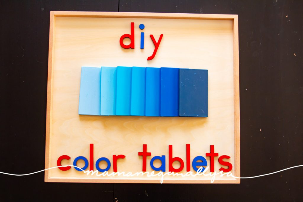 a set of blue color tablets showing a gradient from light to dark on a wood tray with moveable alphabet letters that spell out DIY color tablets