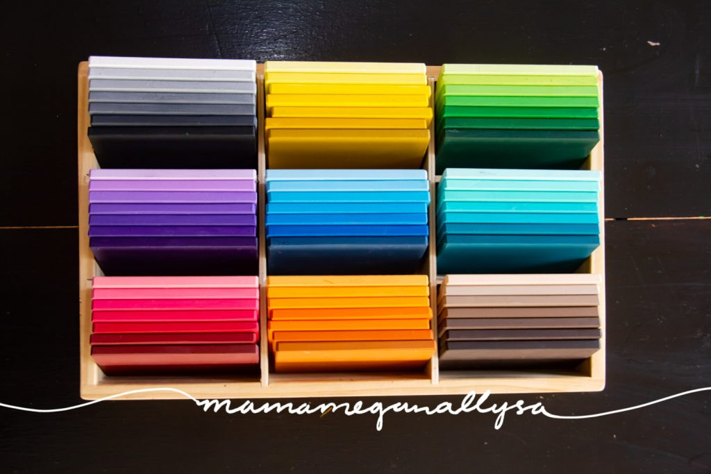 DIY Montessori color tablets neatly arranged in a wooden divided tray