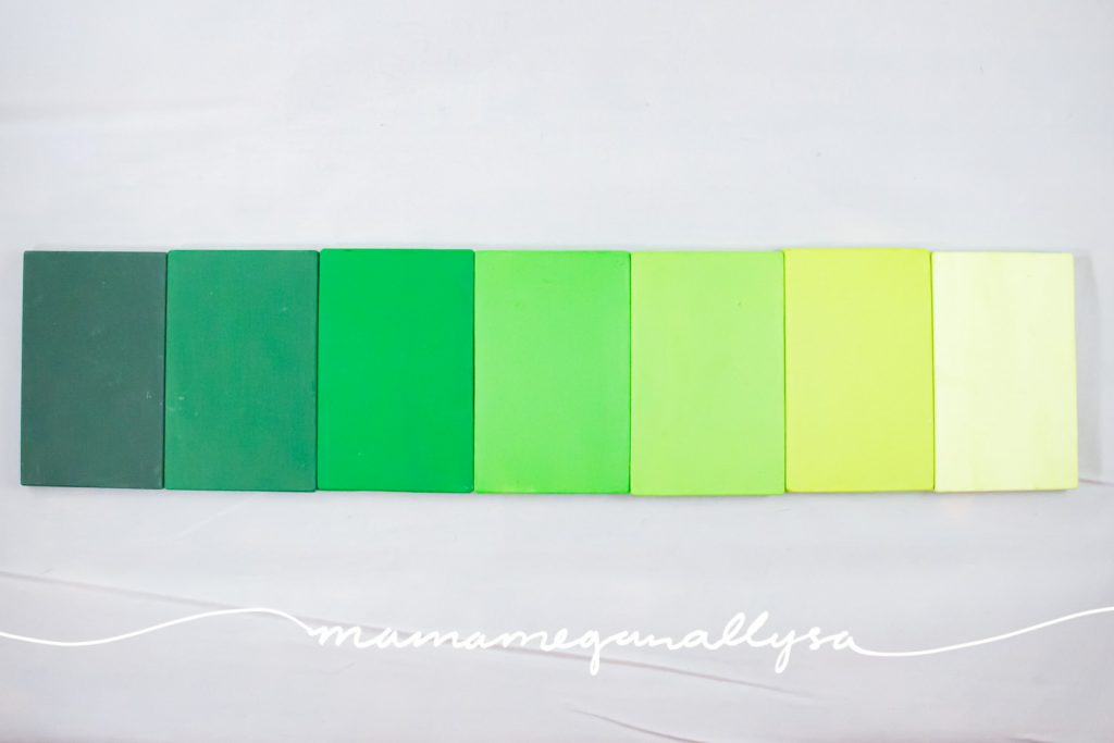 a gradient of 7 green color tablets from dark green to light