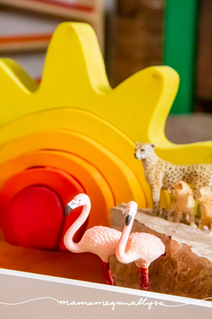 a close-up shot of the flamingos in our safari small world with my DIY sun stacker in the background