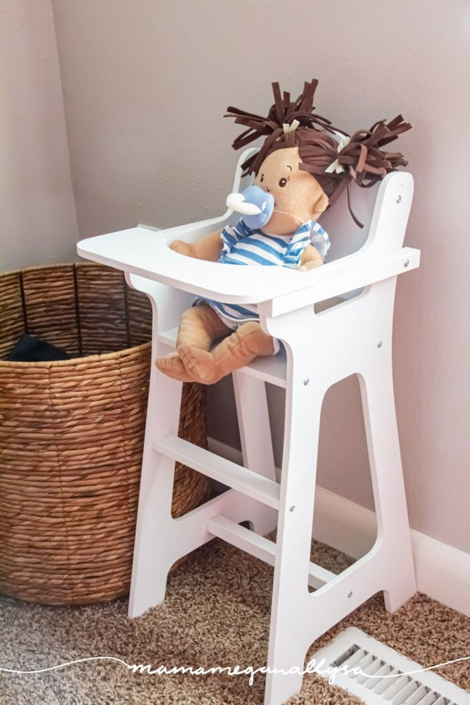 our baby doll corner with a basket and little highchair