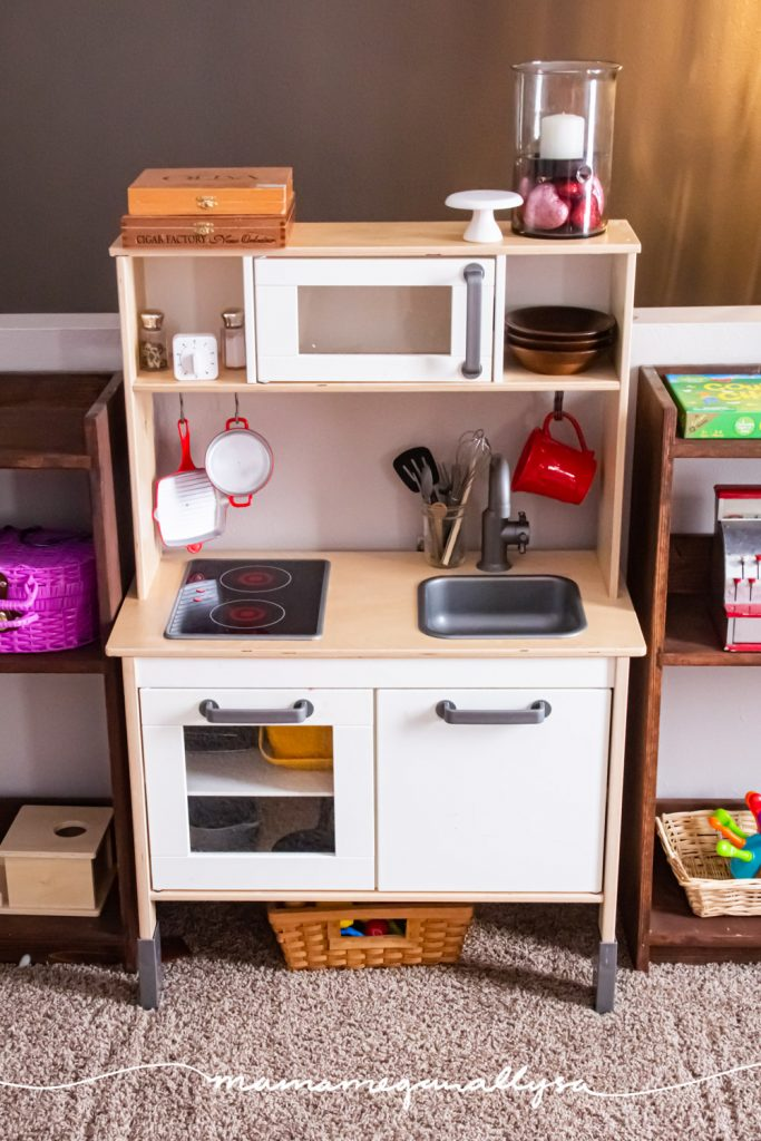 our play kitchen set up between our play shelves in our playroom toy rotation