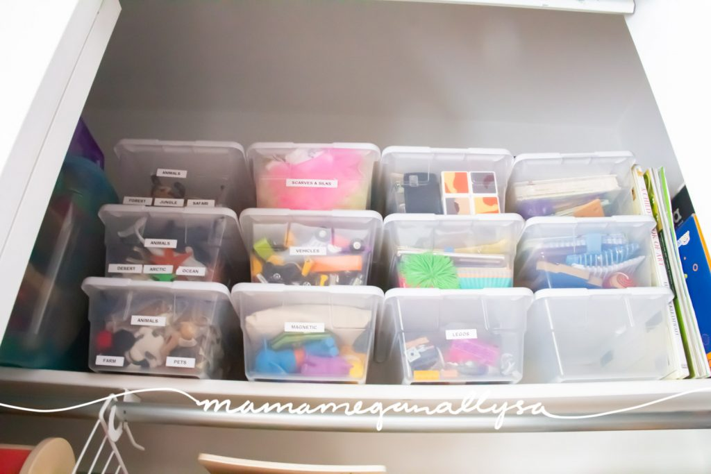 shoebox sized toy storage bins on the top shelf of our toy closet