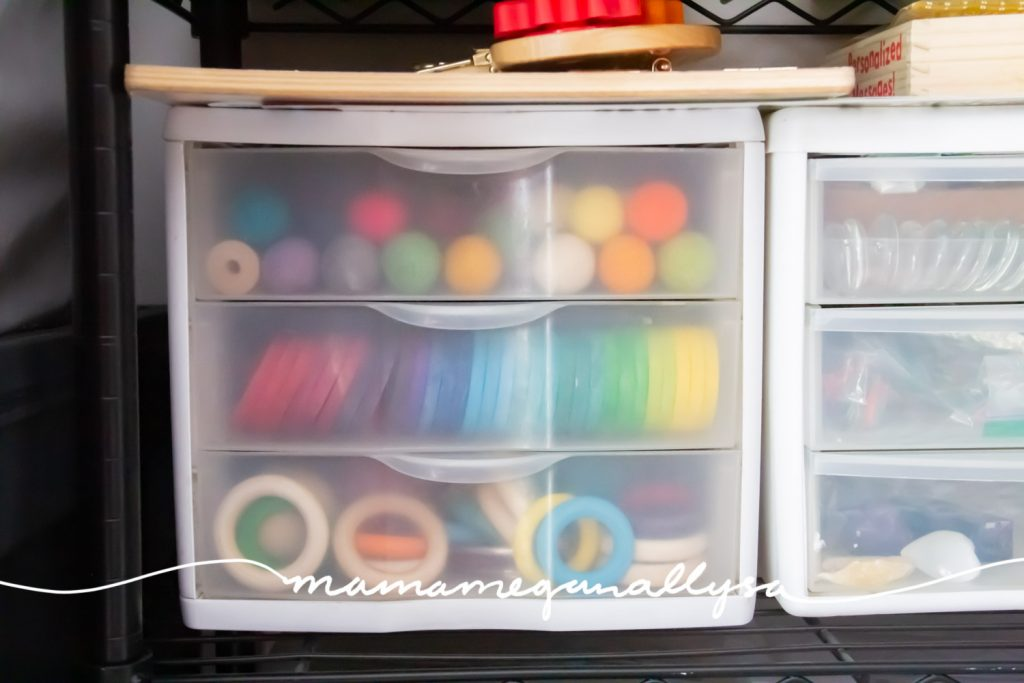 a three drawer organizer holding our wooden loose parts