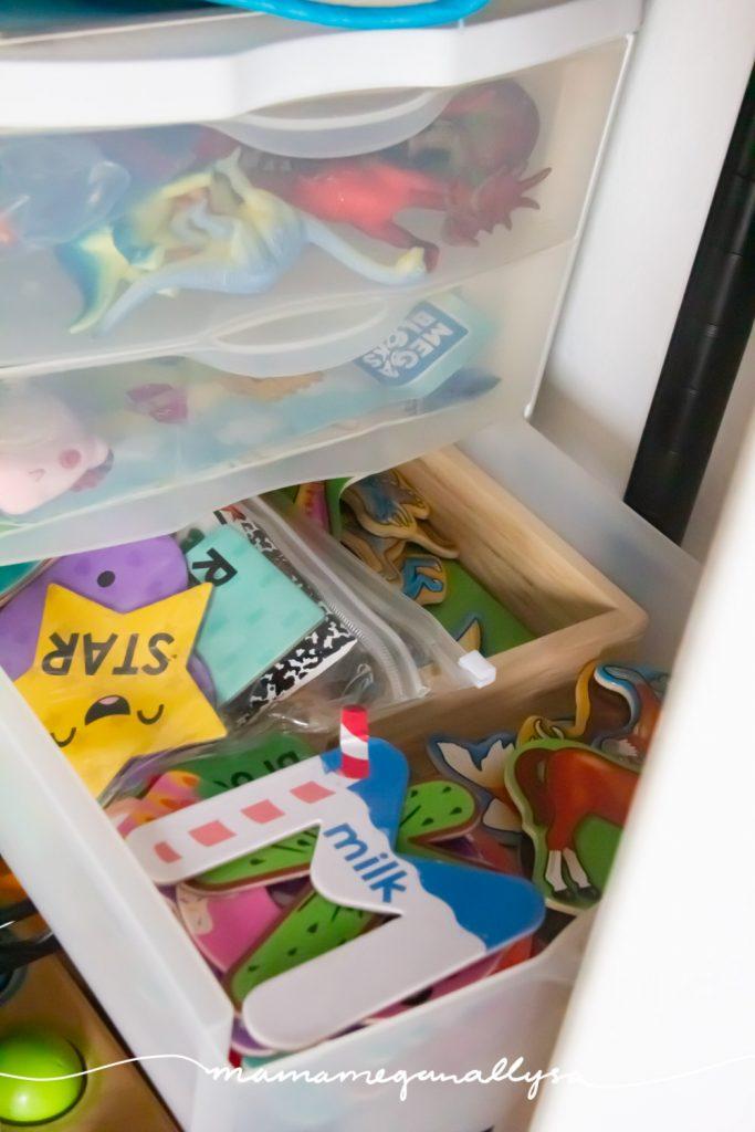 a three drawer organizer holding fridge magnets