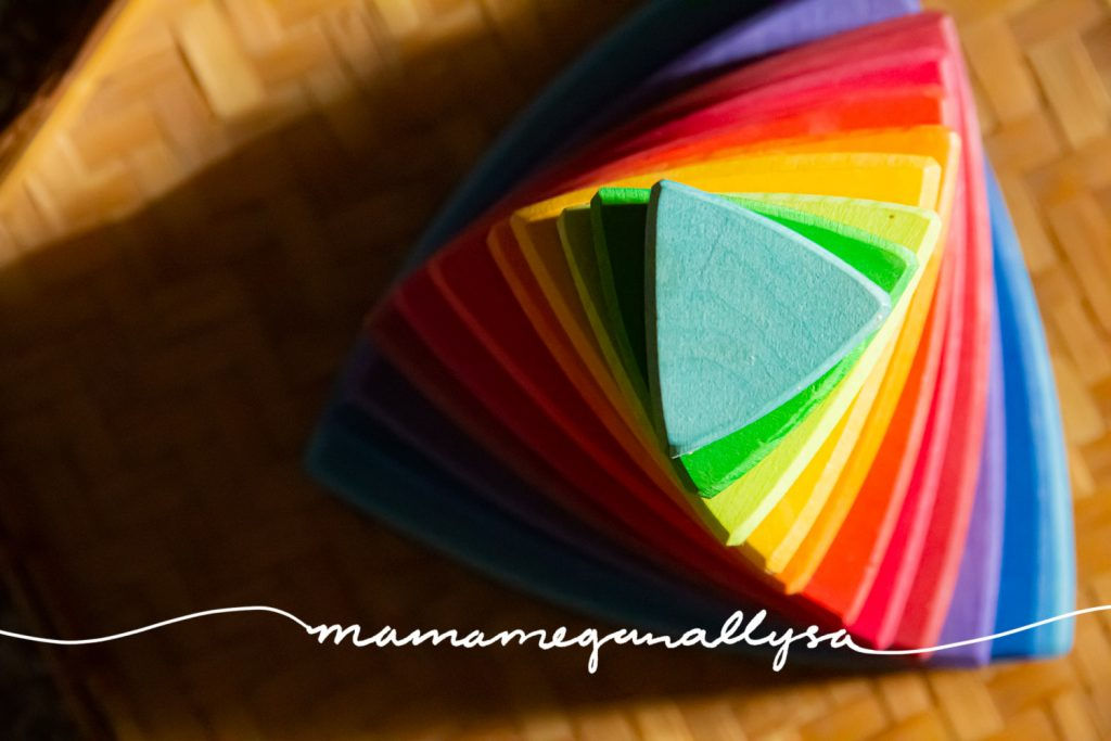 a close up top-down shot of a rainbow Grimms triangle conical tower