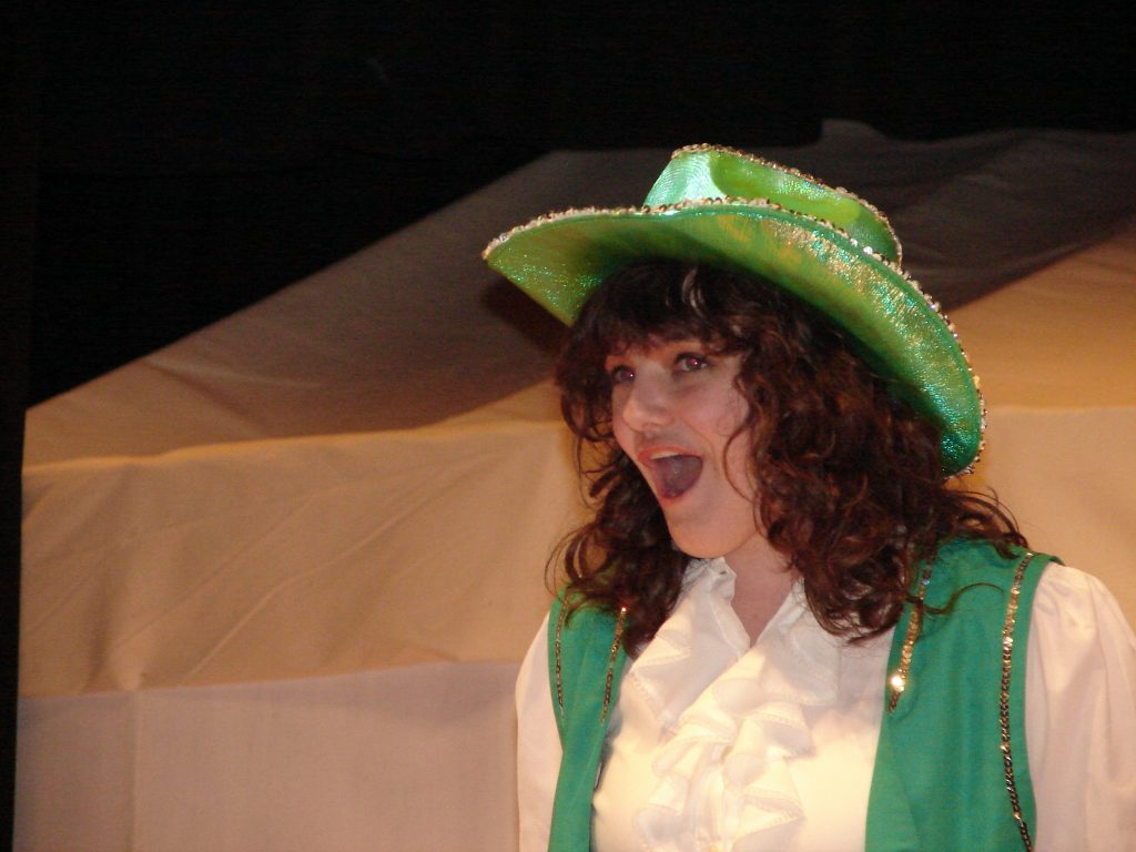 Random facts include a Highschool senior singing in Annie Get Your Gun wearing a green shiny cowgirl hat