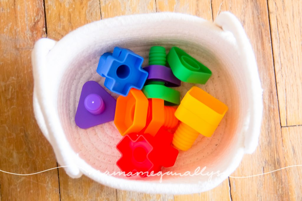 her brightly colored plastic jumbo nuts and bolts