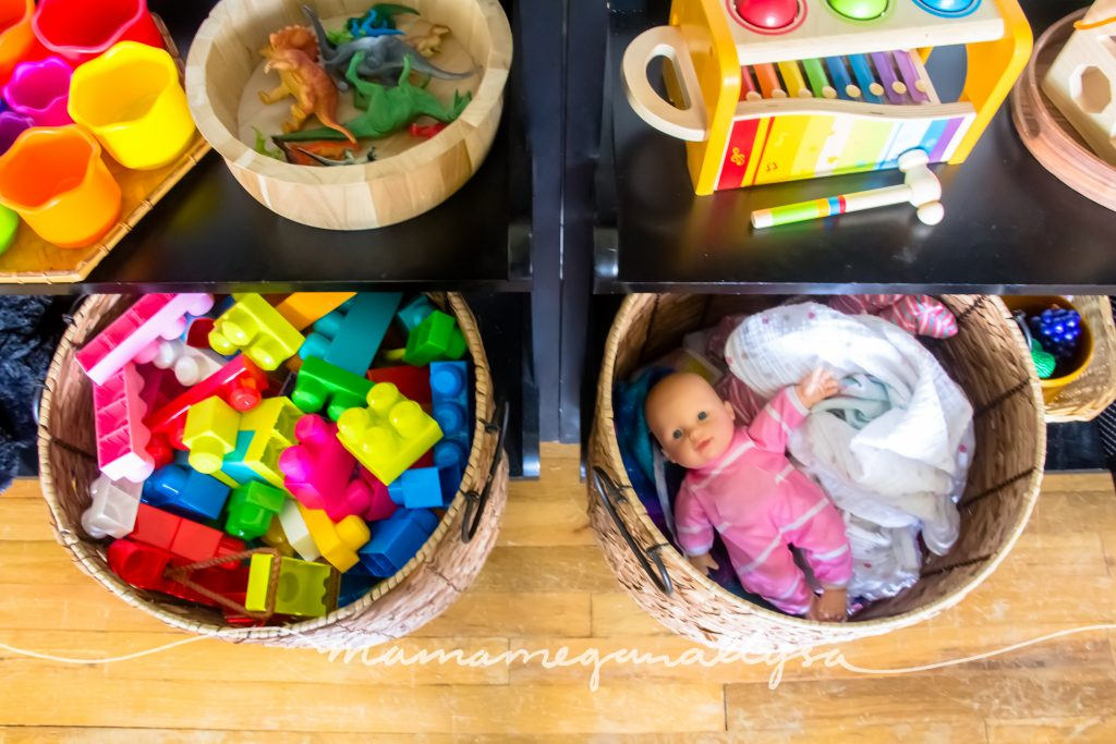 basket with baby dolls and blocks