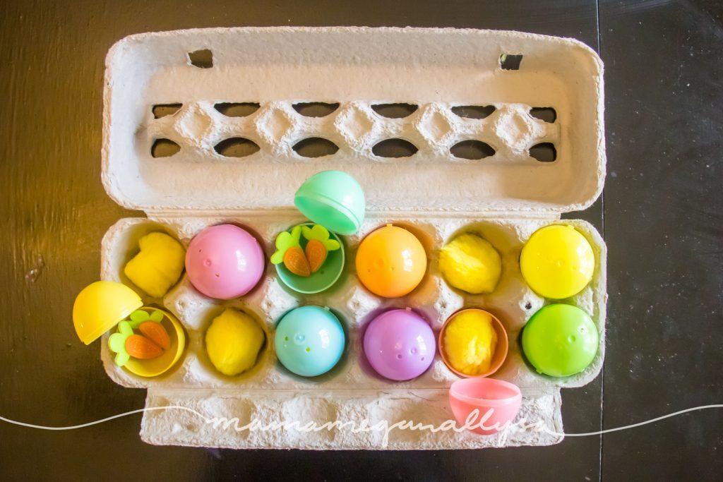 the egg carton, plastic eggs and pompoms